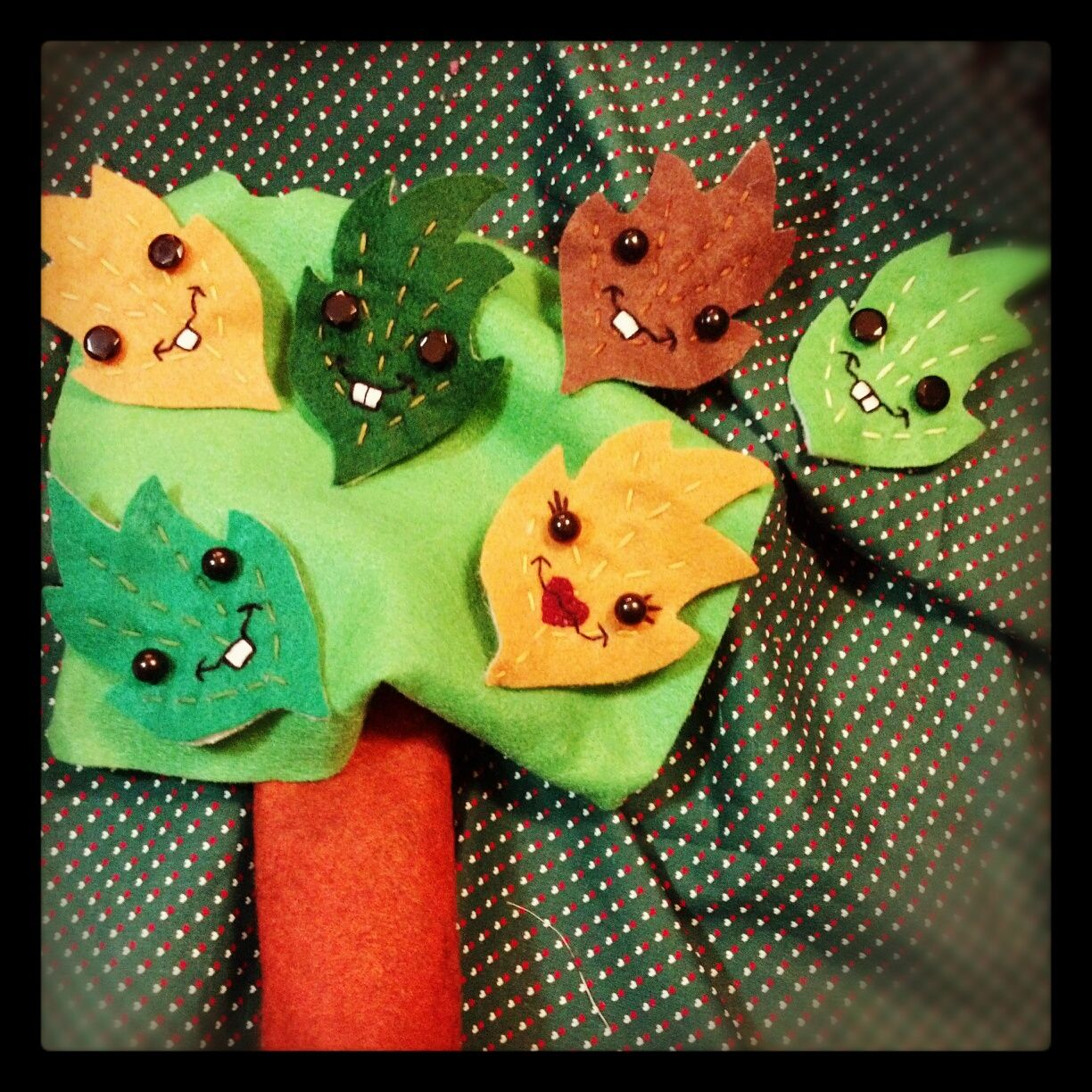 """Assorted """"Happy Fall Leaves"""" felt brooches by Love Nicole Stitchery. Featuring assorted and fun facial expressions and color ways."""