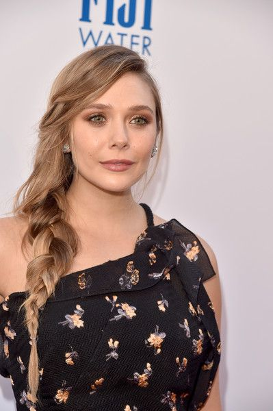 "Actor Elizabeth Olsen attends the premiere of The Weinstein Company's ""Wind River"" at The Theatre at Ace Hotel on July 26, 2017 in Los Angeles, California."