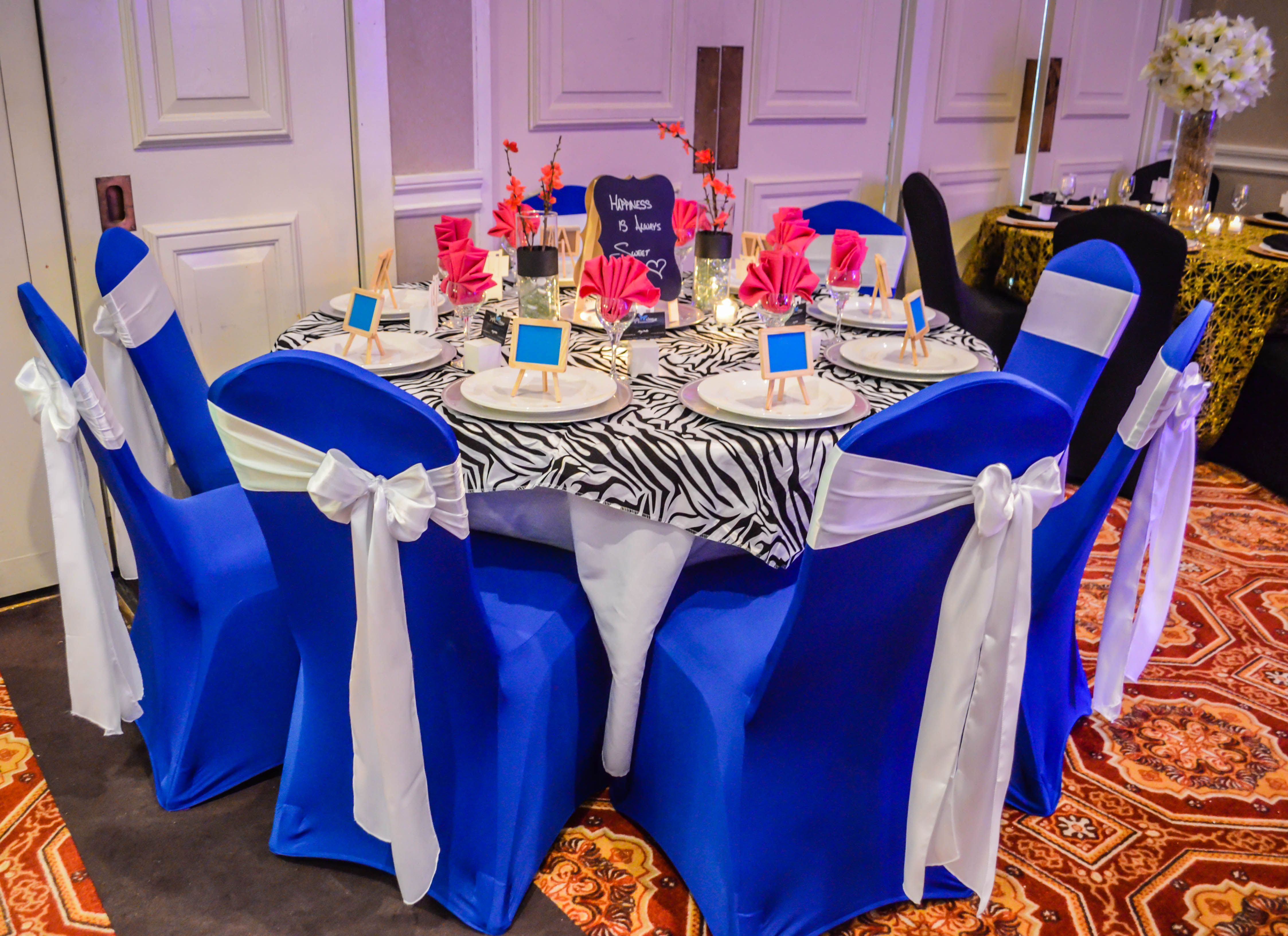 Royal Blue Spandex Chair Covers with White Satin Chair Sashes Zebra