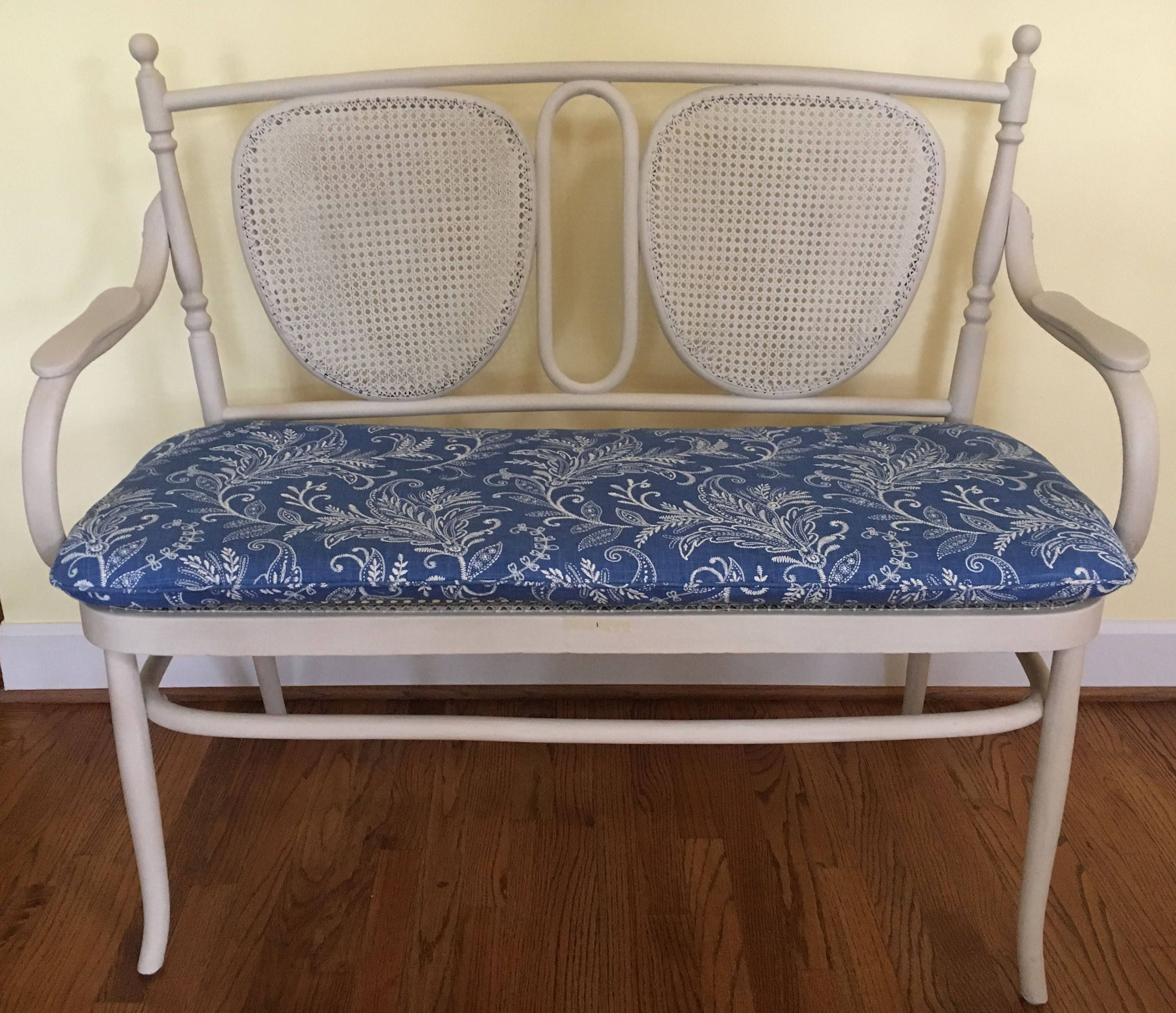 Parisian bistro style caned settee with separate seat cushion and