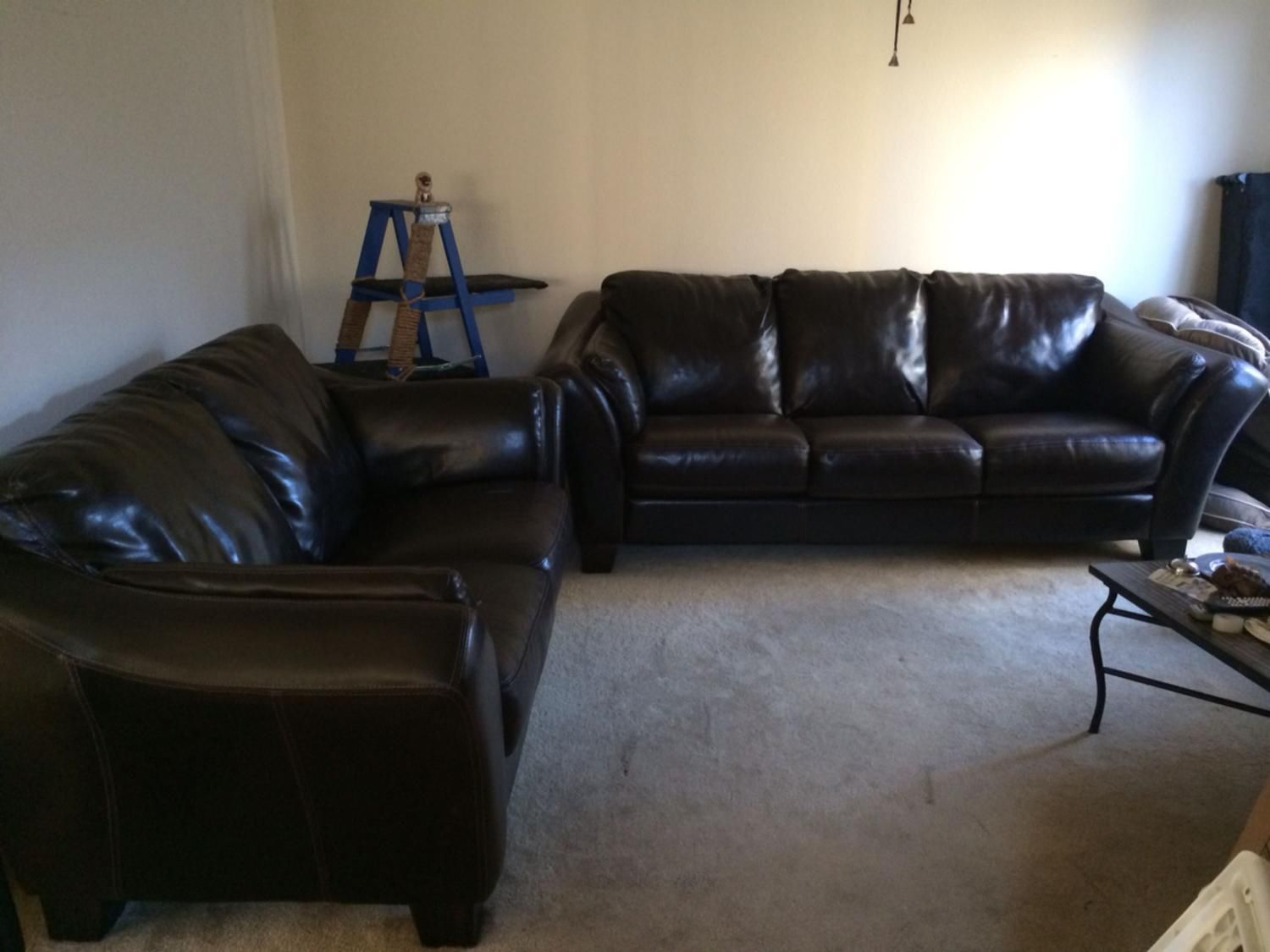 For Sale: Couch + Love-seat - Leather, small rips in love seat cushion