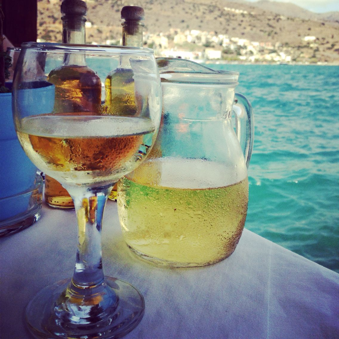 Wine with the lapping waves. Bliss. Elounda, Crete