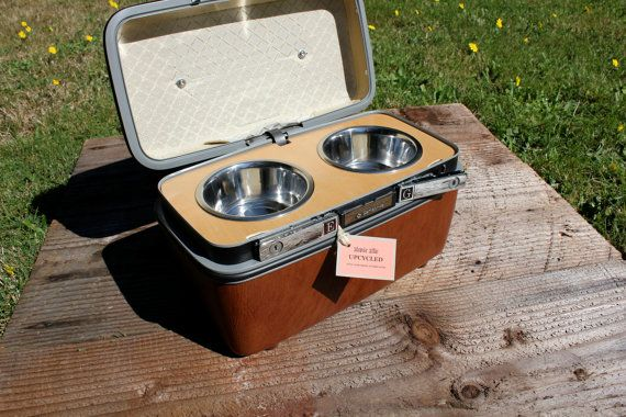 travel case re-purposed into a pet travel feeder~ see these at yard sales and stuff all the time who would have thought lol