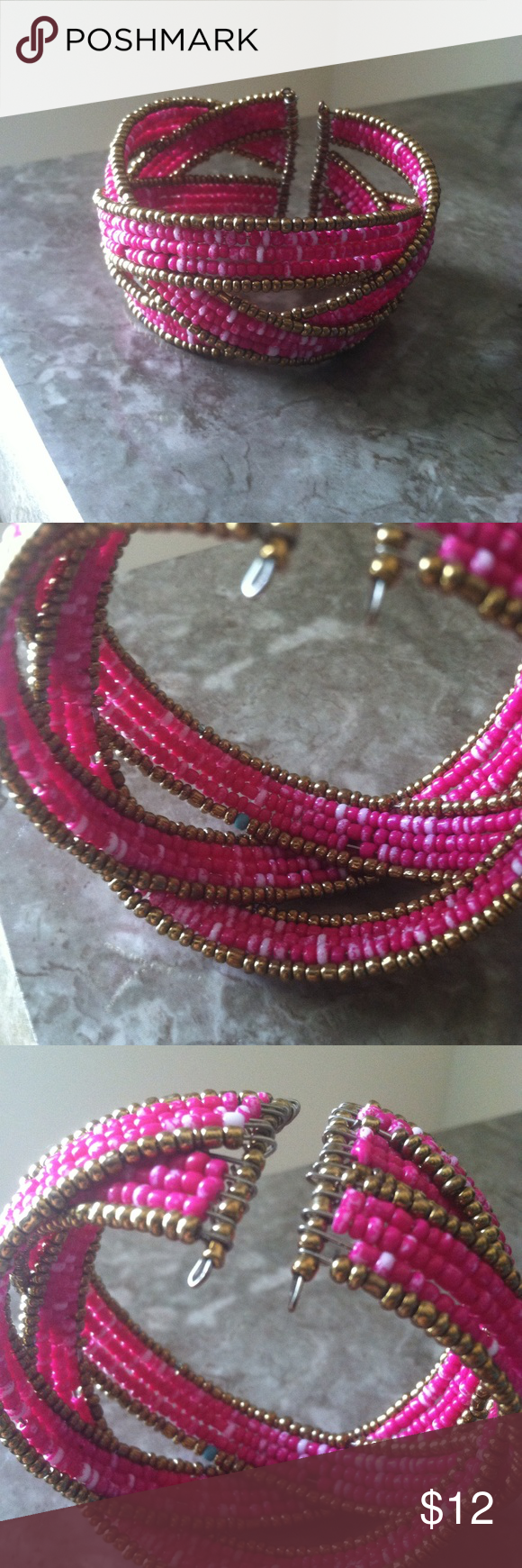 Pink and gold bracelet Beautiful bracelet!! Wonderful colors!! There's one rebel blue bead as shown in picture, but it is not seen when worn!! Jewelry Bracelets