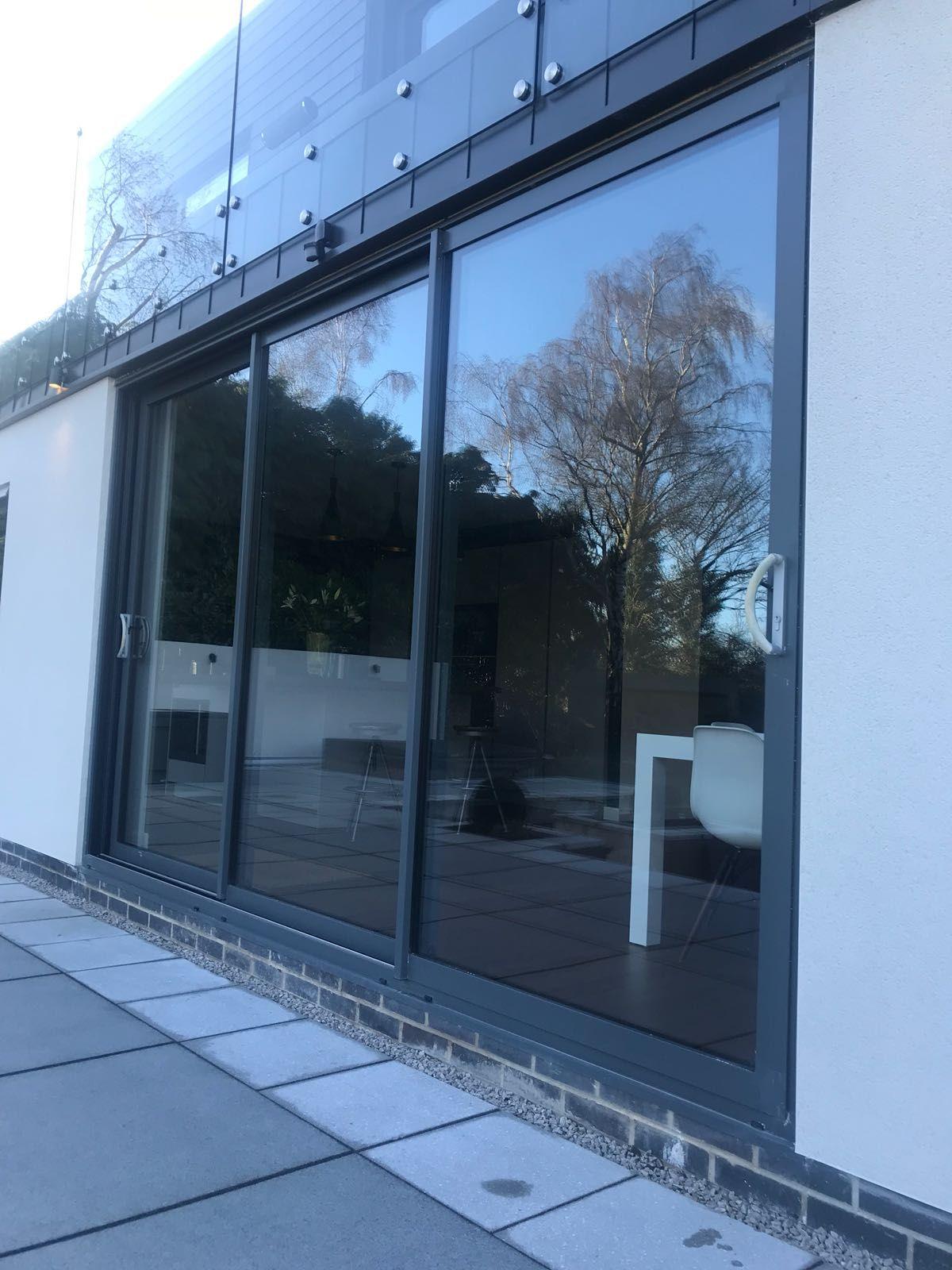 Attrayant Bespoke Iron Grey Smart Architectural Aluminium Triple Track Sliding Patio  Door With Satin Hardware. Installed