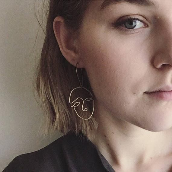 Two metal earrings made with brass, or sterling silver wire