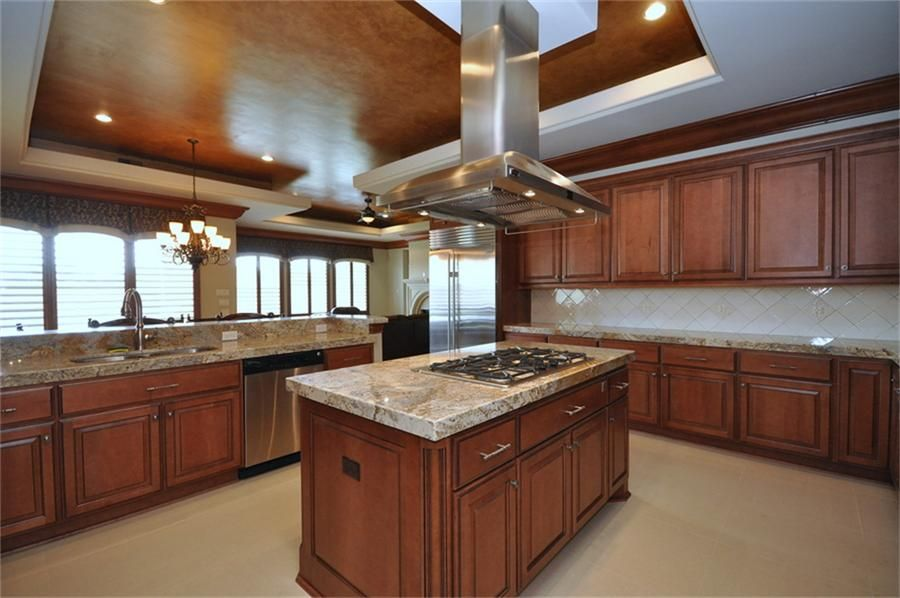 kitchen islands with cooktop | 13727 Slate Creek, Houston ...