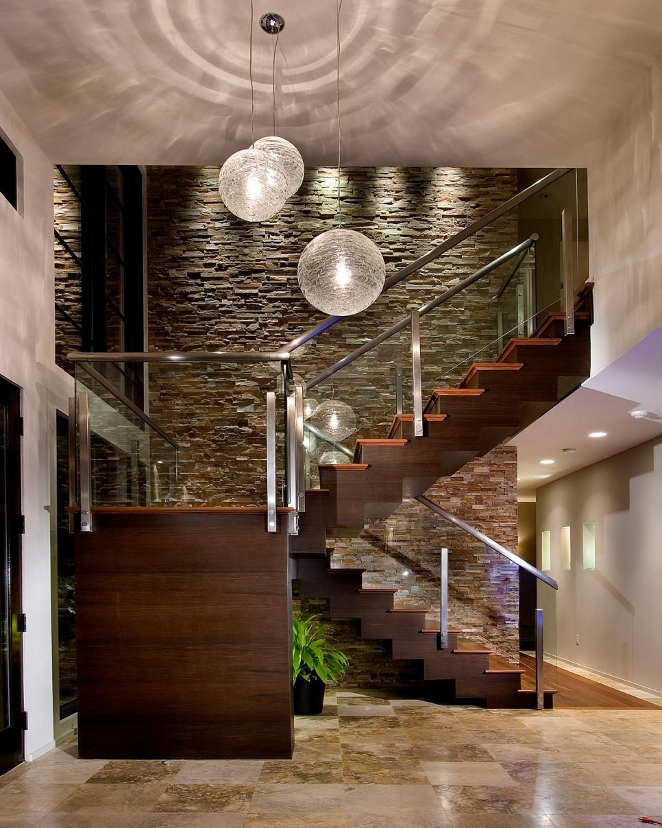 this contemporary foyer dazzles guests upon arrival. a warm wood