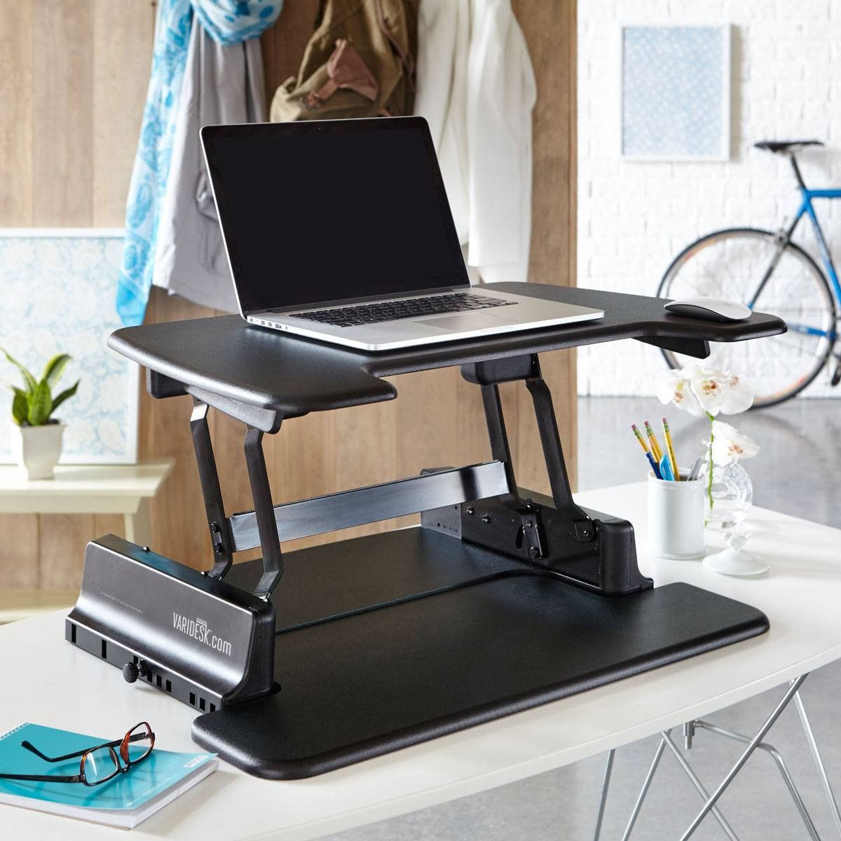 the varidesk laptop 30 gives you two placement options for convenient use of your laptop. Black Bedroom Furniture Sets. Home Design Ideas