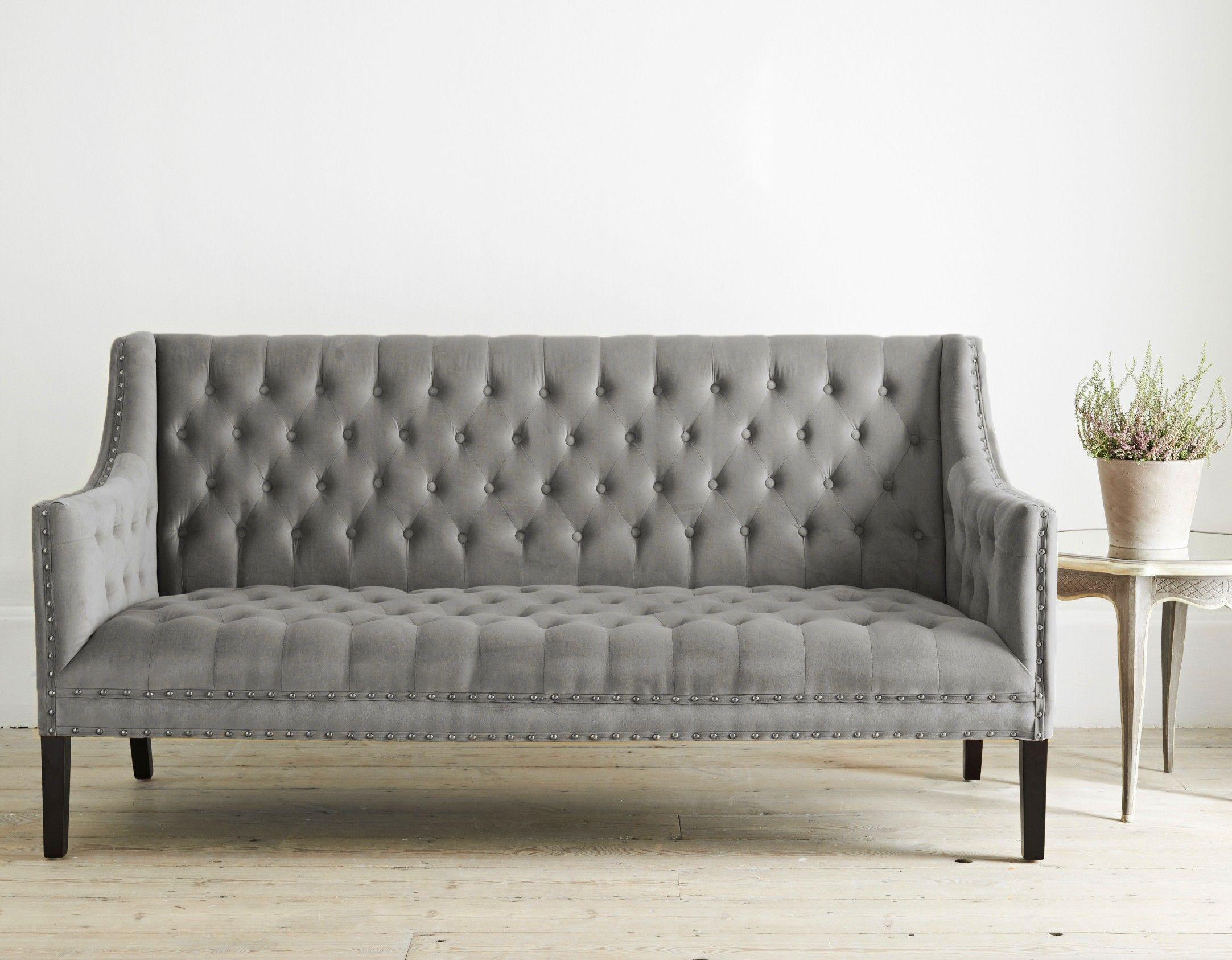 Sophisticated 3 seater sofa in an grey velvet upholstery for Studded sofa sets