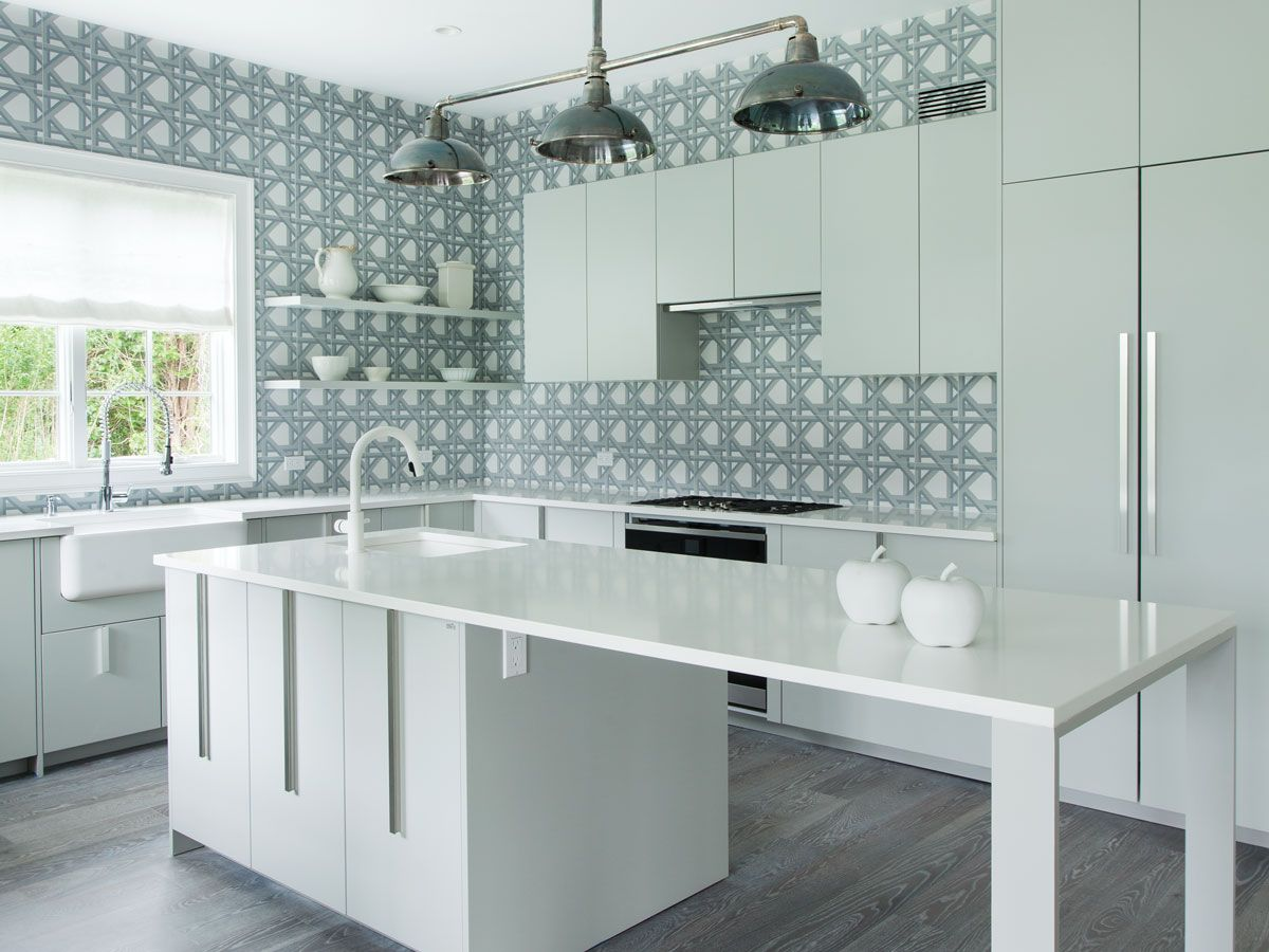 The kitchen cabinetry is by Effeti with white Caesarstone ...