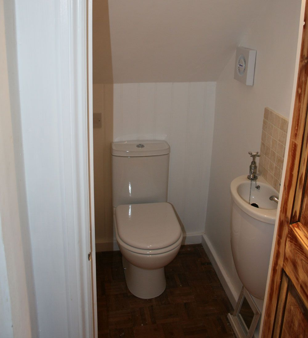 Best Stairs Design Pictures With Toilet Underneath Toilet 400 x 300