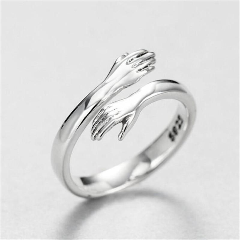 ARE YOU LOOKING FOR THE PERFECT GIFT FOR SOMEONE YOU LIKE?We can proudly present our Hug of Love which is a fantastically valuable gift for someone you love. a hug from you no matter the distance between you.Fits all sizesThe ring is designed to be easily adjusted to the desired size, making it fit all fingers. The gift is suitable for all occasions where you want to show a little extra appreciation, love and friendship to the recipient.✓ High quality material: Created by Sterling Silver✓ Unique