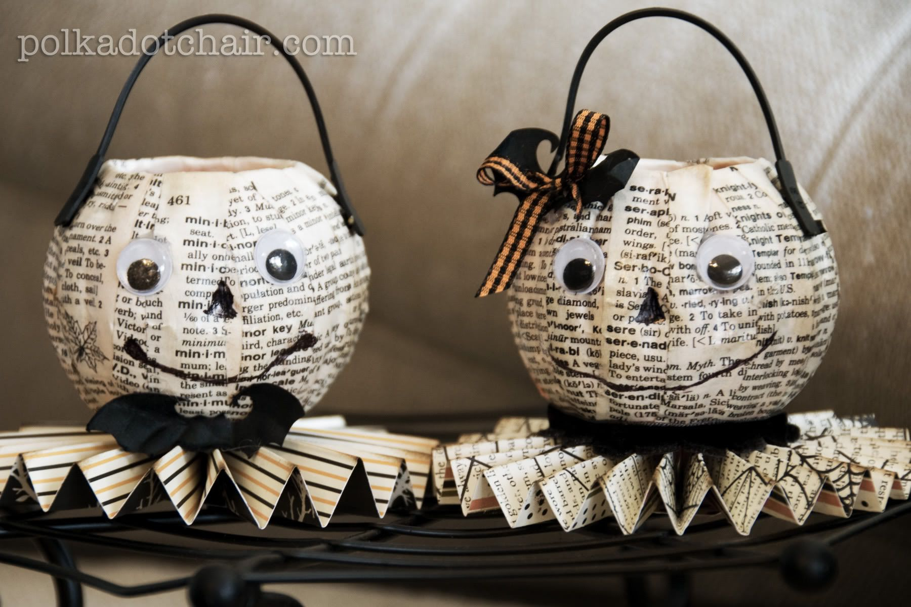 They were made by modge podging a poor neglected destroyed dictionary onto cheap plastic orange pumpkins.