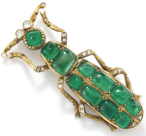 An emerald and diamond beetle pin. Modelled as a stylised beetle, the head, thorax and abdomen set with variously-shaped cabochon emeralds, weighing approximately 25 carats, to brilliant-cut diamond eyes, the legs textured and accented with similarly cut diamonds, length 7.3 cm. Via Phillips.