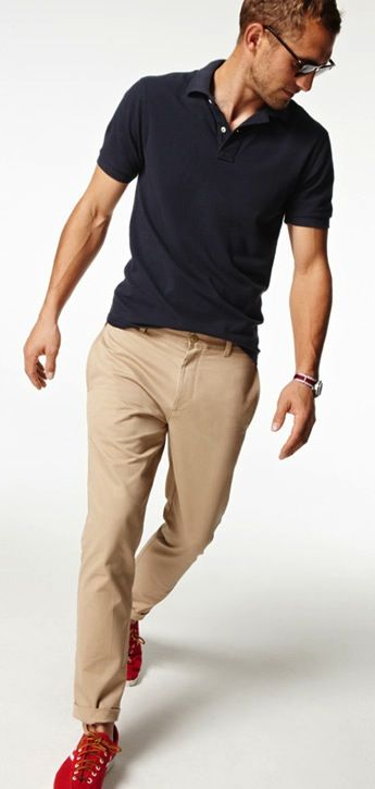 64ed66afc Black polo shirt. Well fitting and khaki chinos. Add a canvas belt to  complete this look. The belt does not need to match the shoes because of  the quite ...