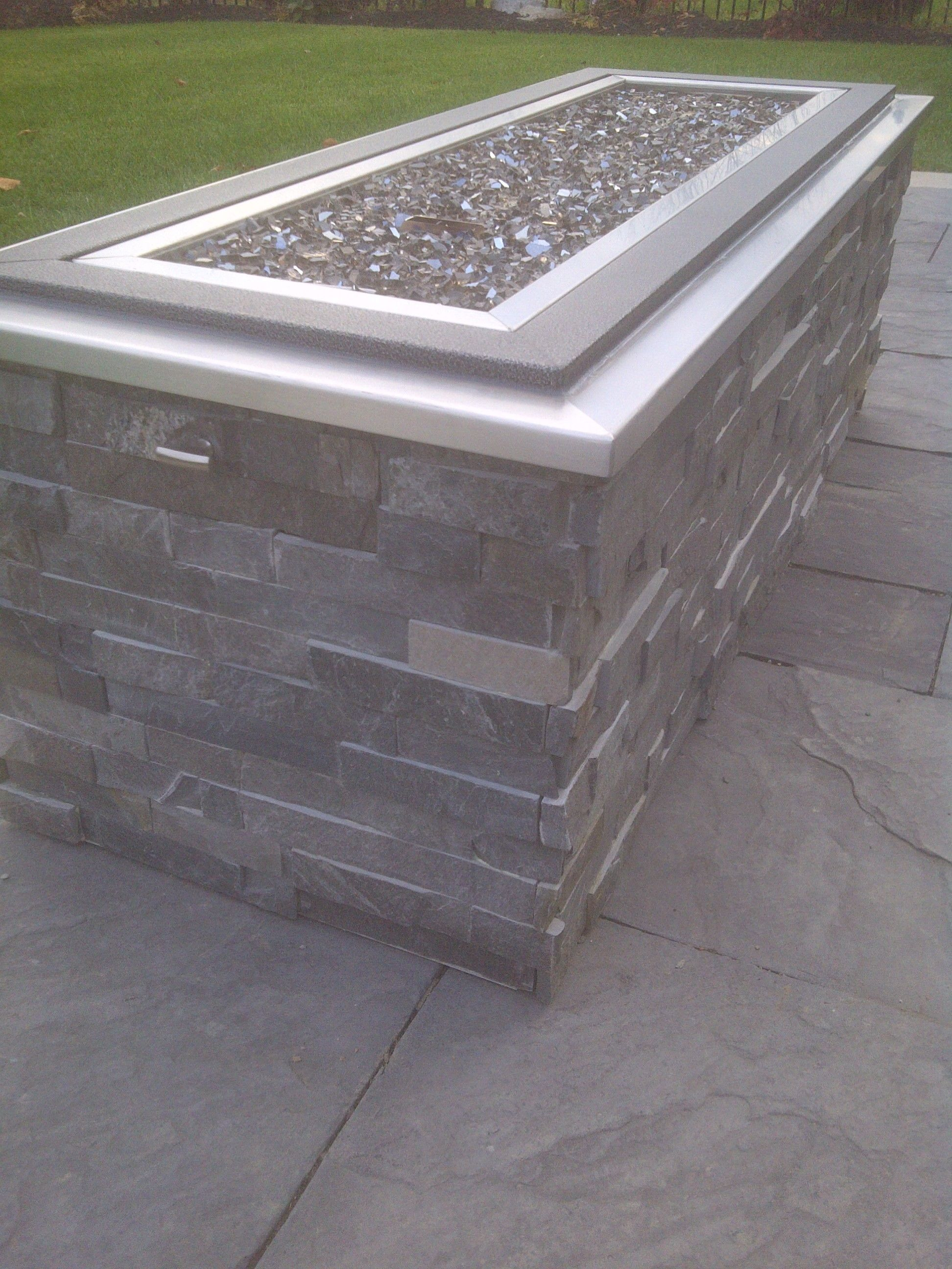 Raised gas fire pit with crushed glass stone cladding and for Fireplace on raised deck