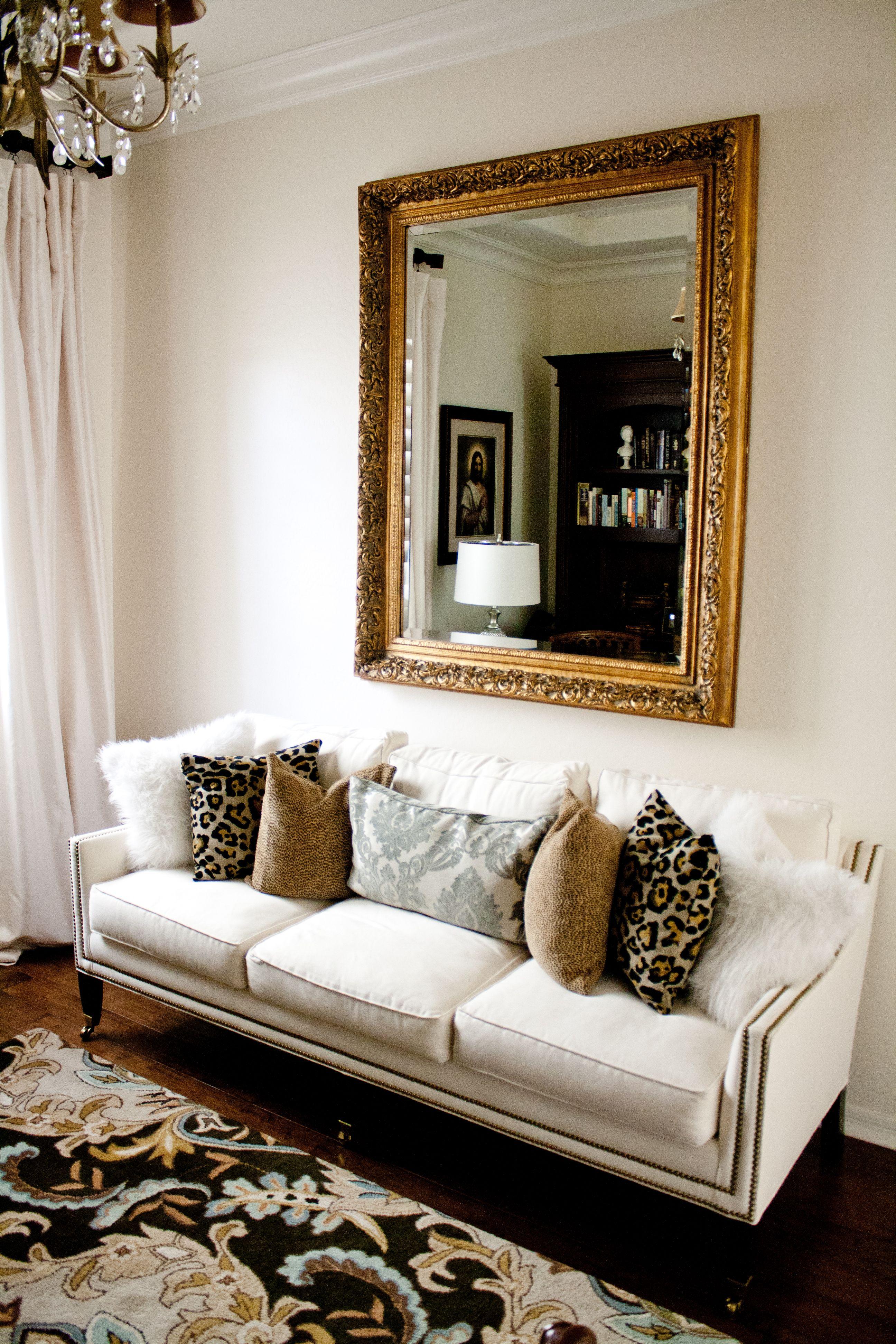efdf96bc7c8 Den with white sofa gold antique mirror leopard pillows white walls antique  chandelier fur pillows jpg