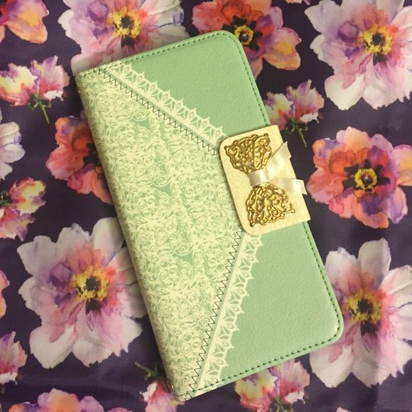 iPhone 6/6S Plus wallet phone case  A super cute spring green wallet case for IPhone 6/6s Plus. Has 3 tabs to put your belongings in like a wallet. Fits phone perfectly! Accessories Phone Cases