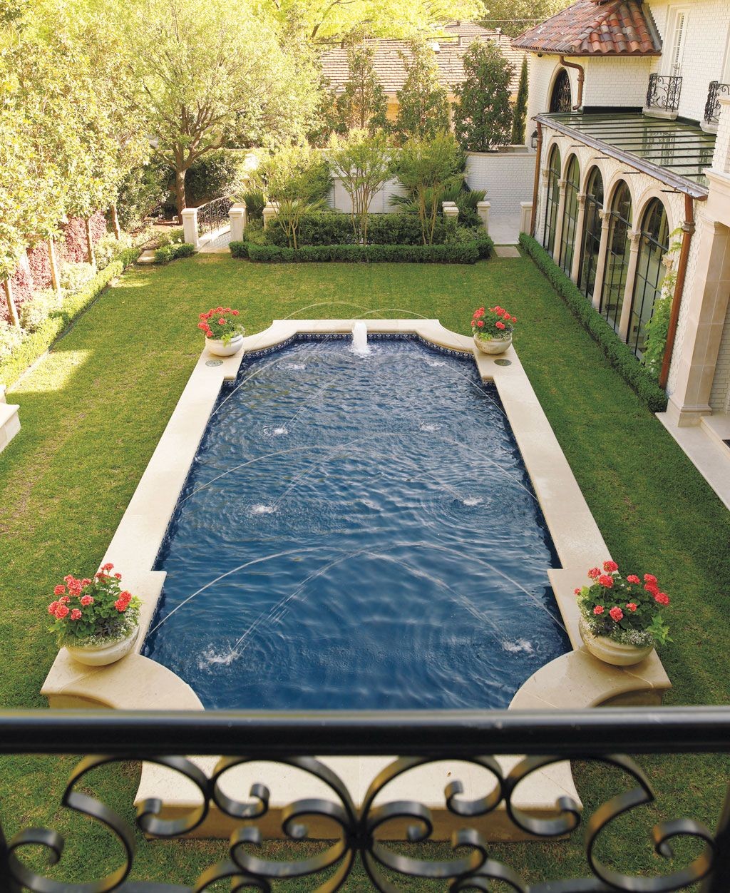 Classic Pool Shape Raised Off Of Ground Backyard