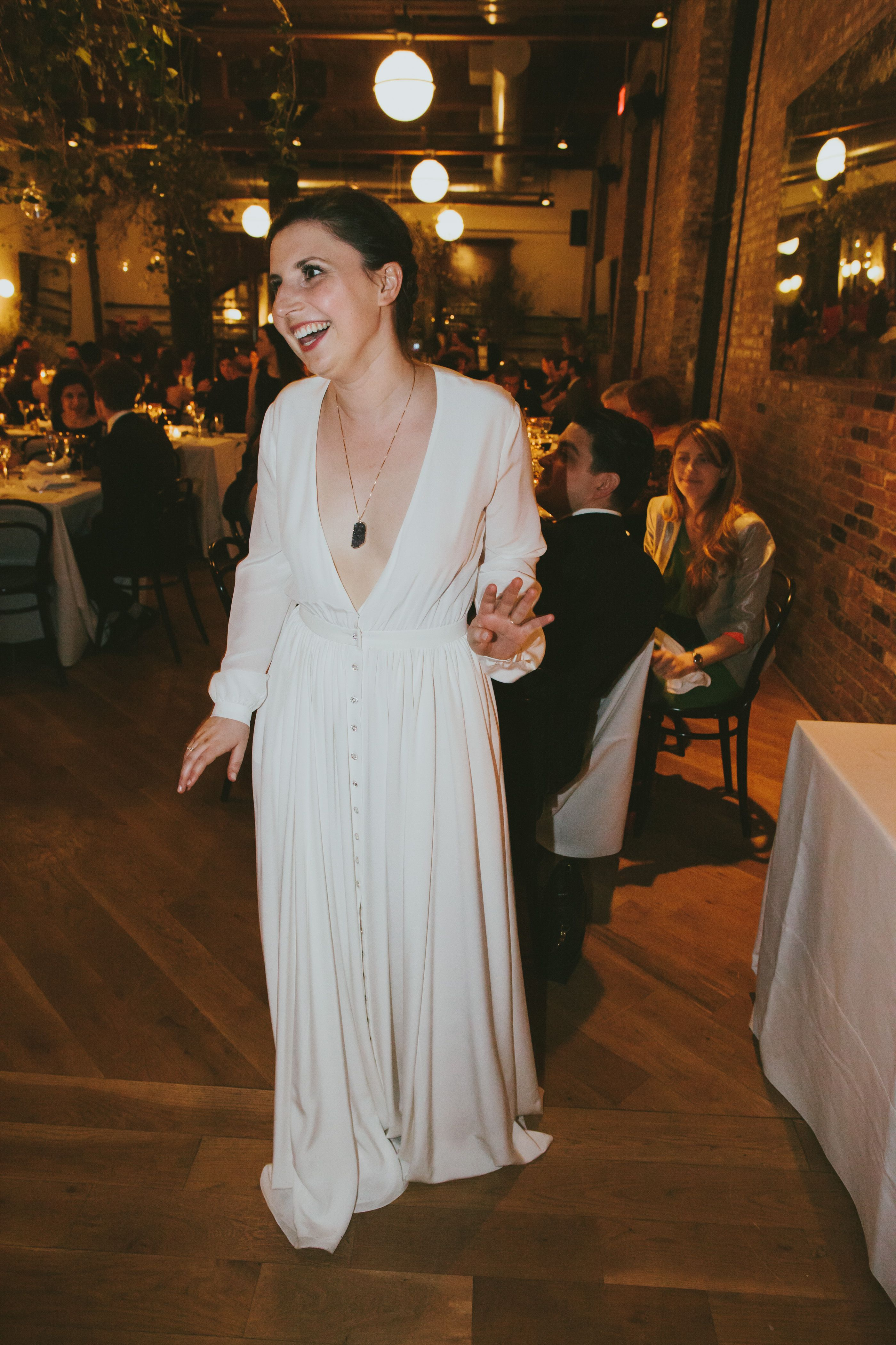 A Real Houghton Bride In Her Deep V Neck Galina Gown With Long Sleeves And Swarovski Buttons Visit The Nyc Houg Houghton Bride Nyc Boutiques Wedding Dresses