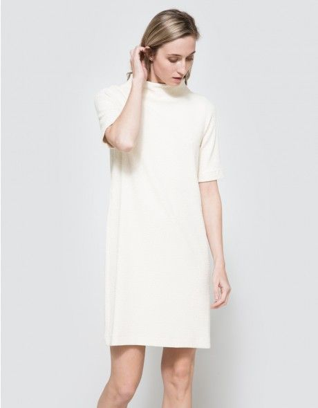 6af624c3 THOMPSON DRESS. From Ganni, a minimalist dress in Vanilla Ice. Features a  high rounded neck, crepe texture pattern, short sleeves, straight hem and a  ...