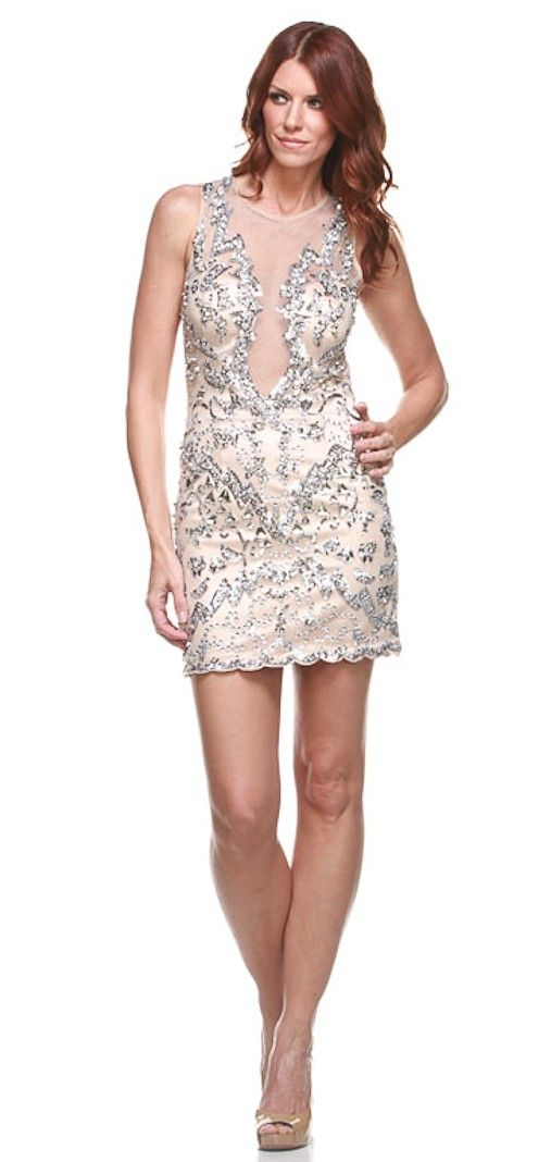 This dazzling Musani dress is a must have for your next Vegas adventure. This all over sequin dress has a nude underlay with beautiful intricate beading and sequin detail. The front has a unique front with its plunging neckline, but still has mesh over top to show just the right amount of skin. There are padded cups in the inside and a side-hidden zipper.  Note: Fits normal, but doesn't have a lot of stretch  Note: As seen on Caitlin O'Connor  Color: Nude Fabric: 75% triacetate 255 polye…