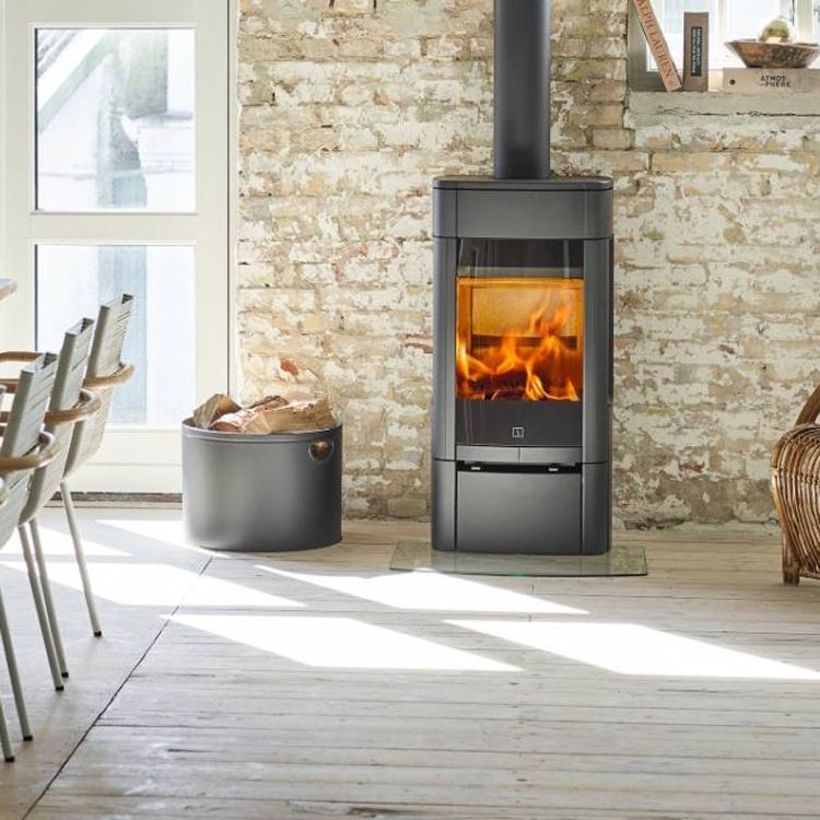 The Gorgeous Scan 65 2 Low Base Wood Burning Stove From Scanstoves Featured He Contemporary Wood Burning Stoves Wood Burning Stove Wood Burning Stove Corner