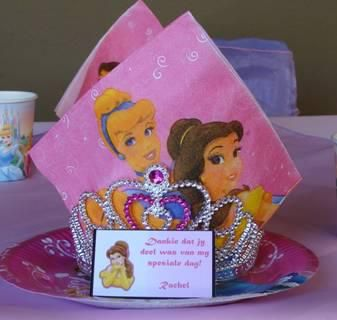 Disney princess kids party decor- A crown on a plate with a serviette and thank you note