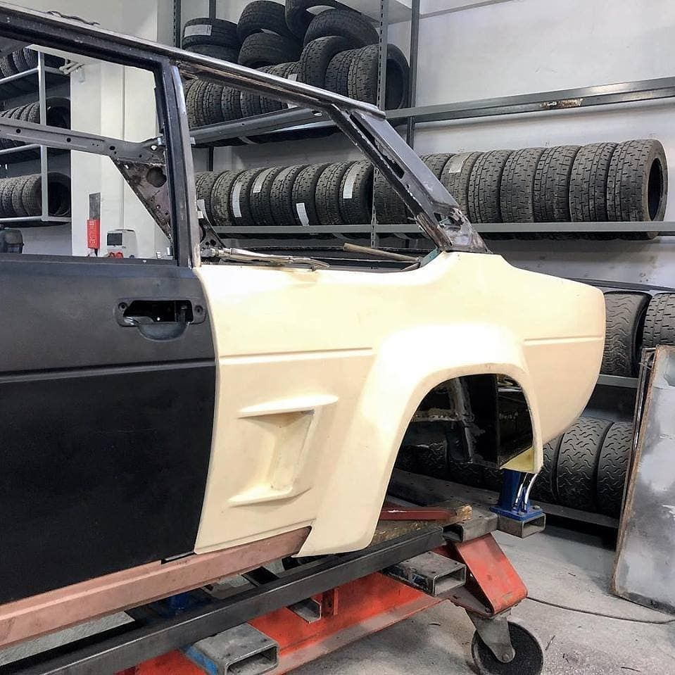 Fiat 131 Abarth Being Equipped As A Rally Car On A Celette Car