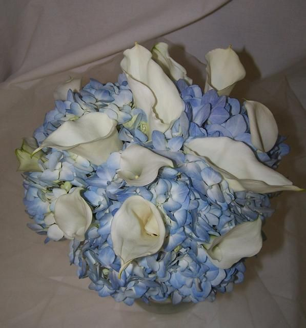 Light Blue Wedding Altar Arrangements: Hand-Tied Bouquet Of Blue Hydrangeas And Ivory Callas