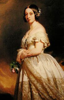 A young capture of Queen Victoria, wearing a small diamond and sapphire tiara at the back of her head, in a painting by Franz Xaver Winterhalter.