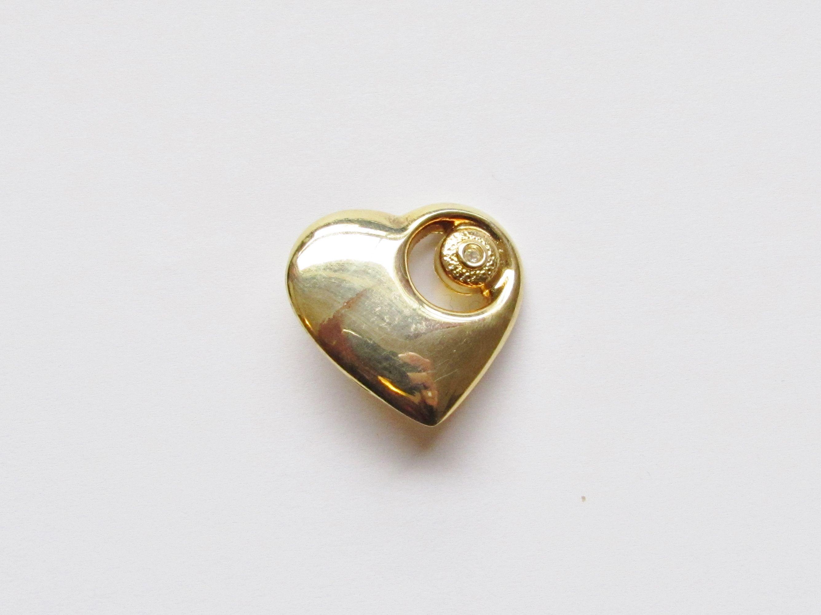 Golden heart broche