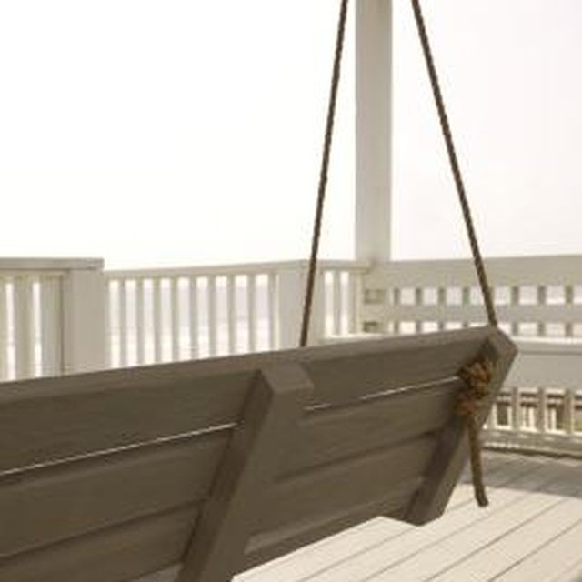 How To Hang A Porch Swing With Rope Hunker Porch Swing Hanging Porch Swing Simple Benches