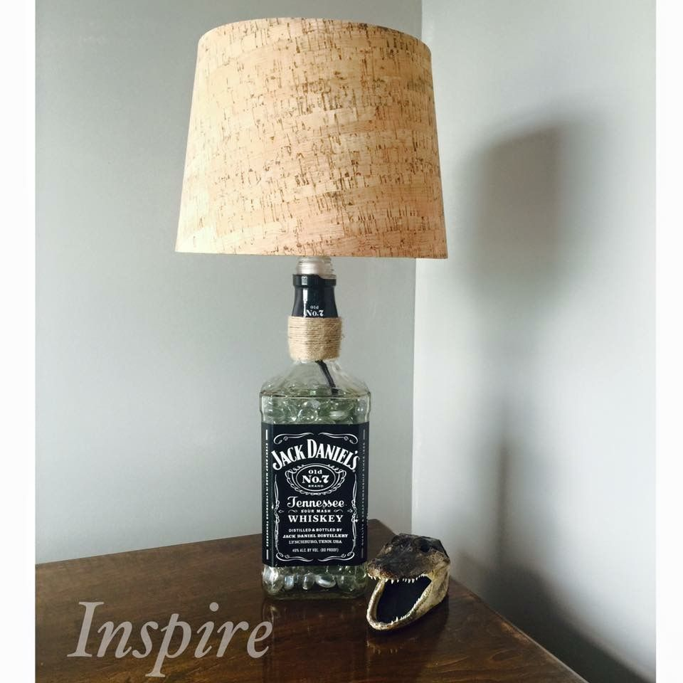Repurposed Jack Daniels Lamp. Mans Cave. Mans Cave Decor. Jack Daniels.   This Awesome piece was a gift from me and my mother to my amazing husband. The Lamp is made from a Jack Daniels Bottle and Cork Lamp Shade and some Glass Pebbles.   These are available For Sale on Our Facebook Page!! #Inspire