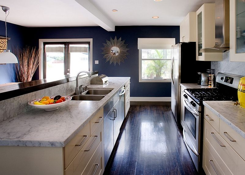 White Carrera Marble Cream Cabinets And Navy Blue Walls Define This Trendy Kitchen Decoist