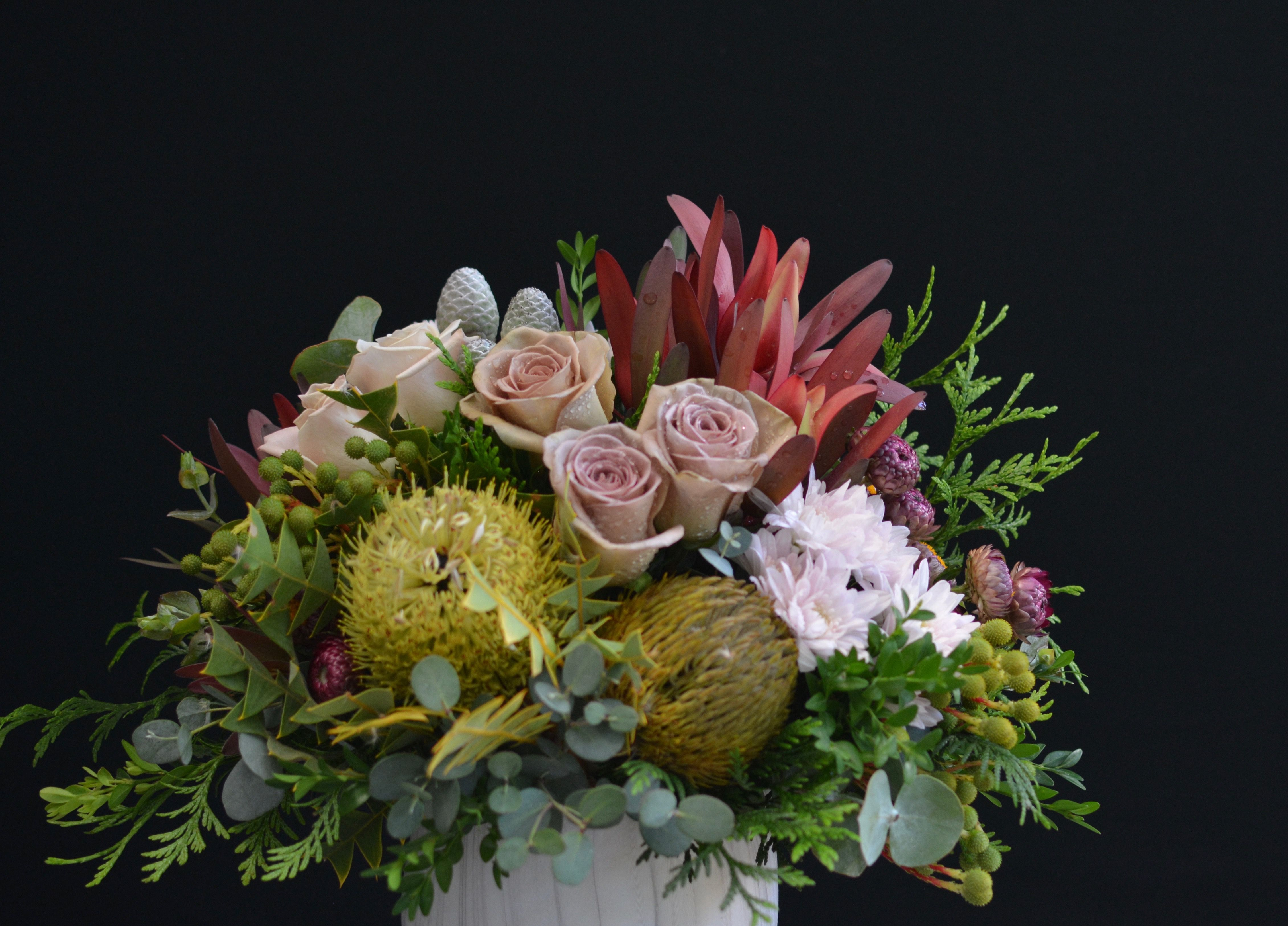 Soft roses and natives in a marbled pot softcolours