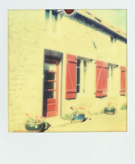 France polaroid by Photography King, via Flickr. Taken on a sx70 with ND filter 680.