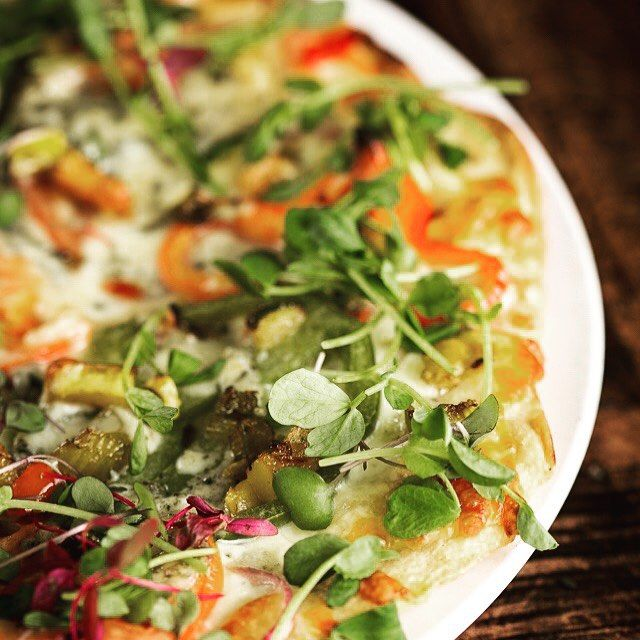 Vegan and gluten-free pizza topped with roasted butternut squash, caramelized onions, mission figs, Daiya cheese and spicy micro greens.