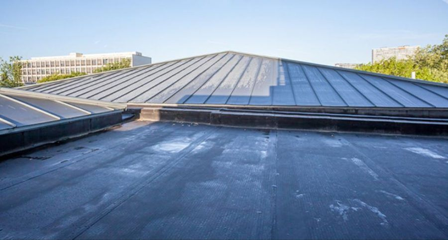 Should You Have A Walkway On Your Roof Flat Roof Roofing Systems Commercial Roofing