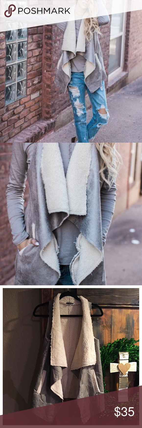 Pocketed vest New without tags faux leather pocketed vest in a grey hue. Dry clean only Jackets & Coats Vests