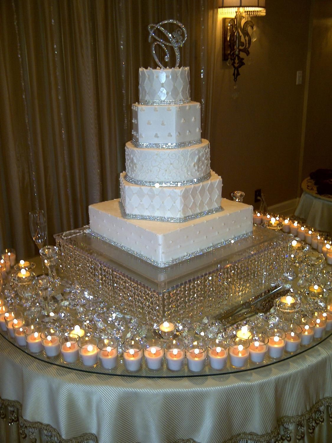 Add candles around the wedding cake table for a more
