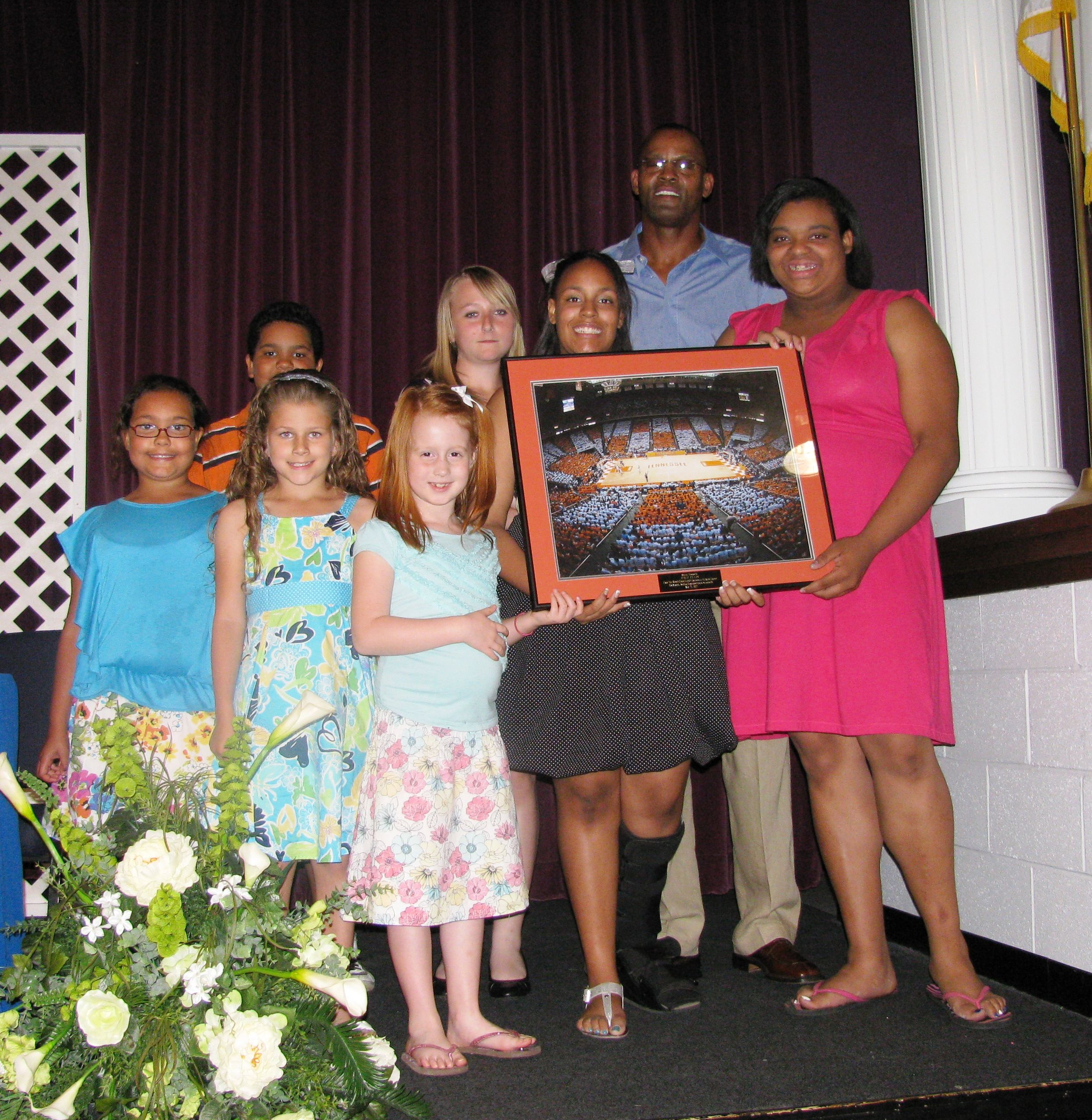 Club kids present Dale Ellis with a t at the Boys & Girls Club