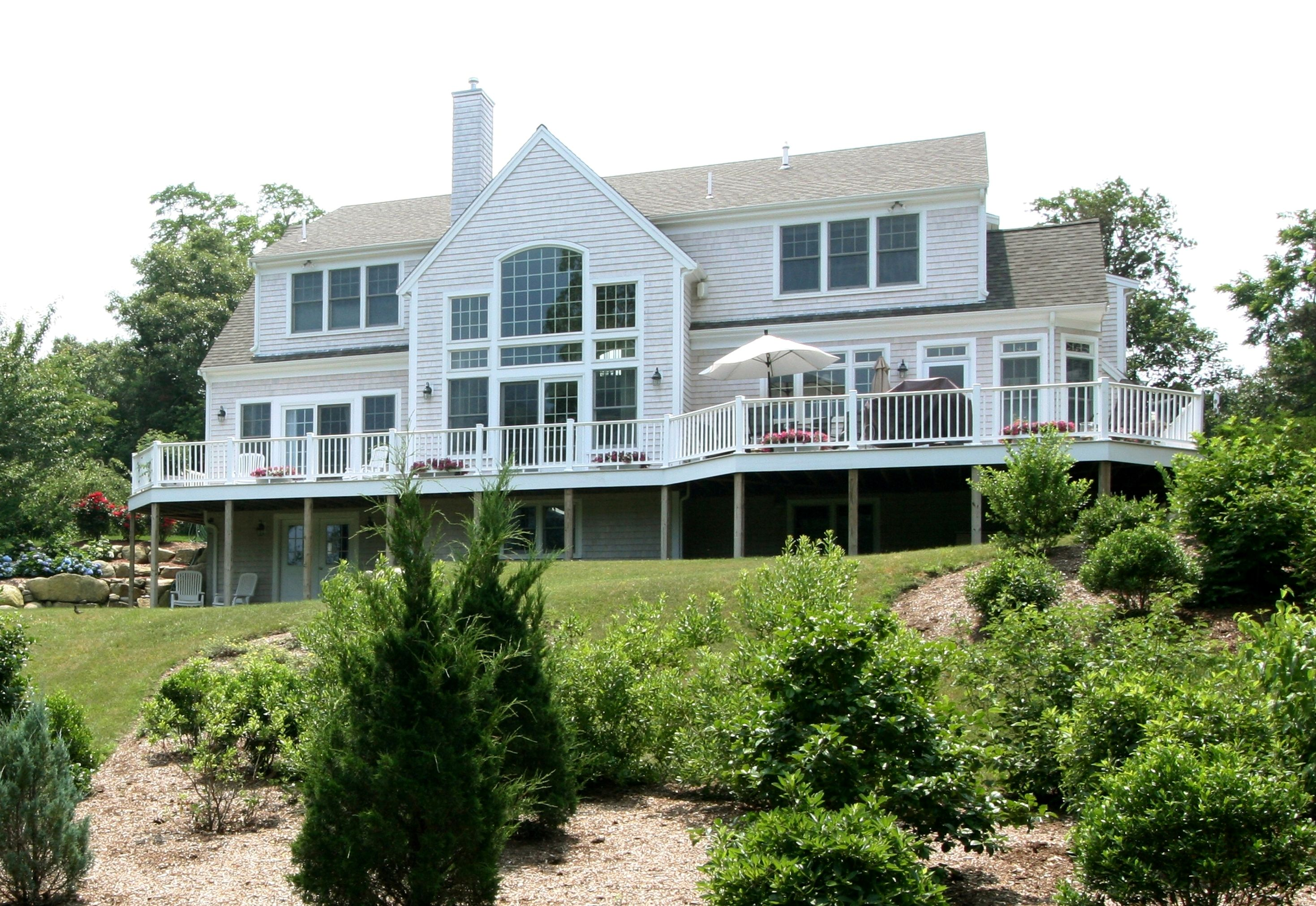 Exterior of beautiful cape cod home in orleans built by for Cape cod builder