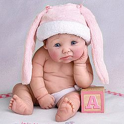 This is a collectible sculpted baby! So cute!