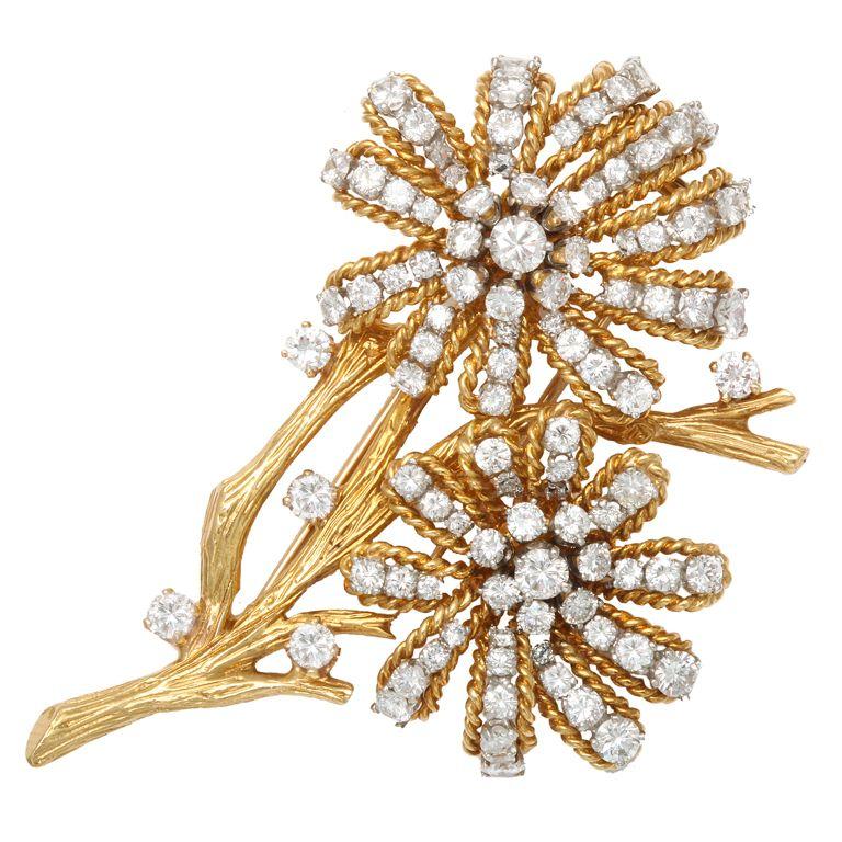 VAN CLEEF & ARPELS Double Blossom Diamond Gold Flower Pin. Diamonds 8 carats. Circa 1970s