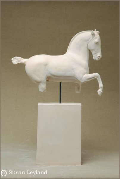 Bucephalus Wins by Susan Leyland. 18 1/2 x 2 1/2 x16 1/8″ Terracotta clay. Price upon request.