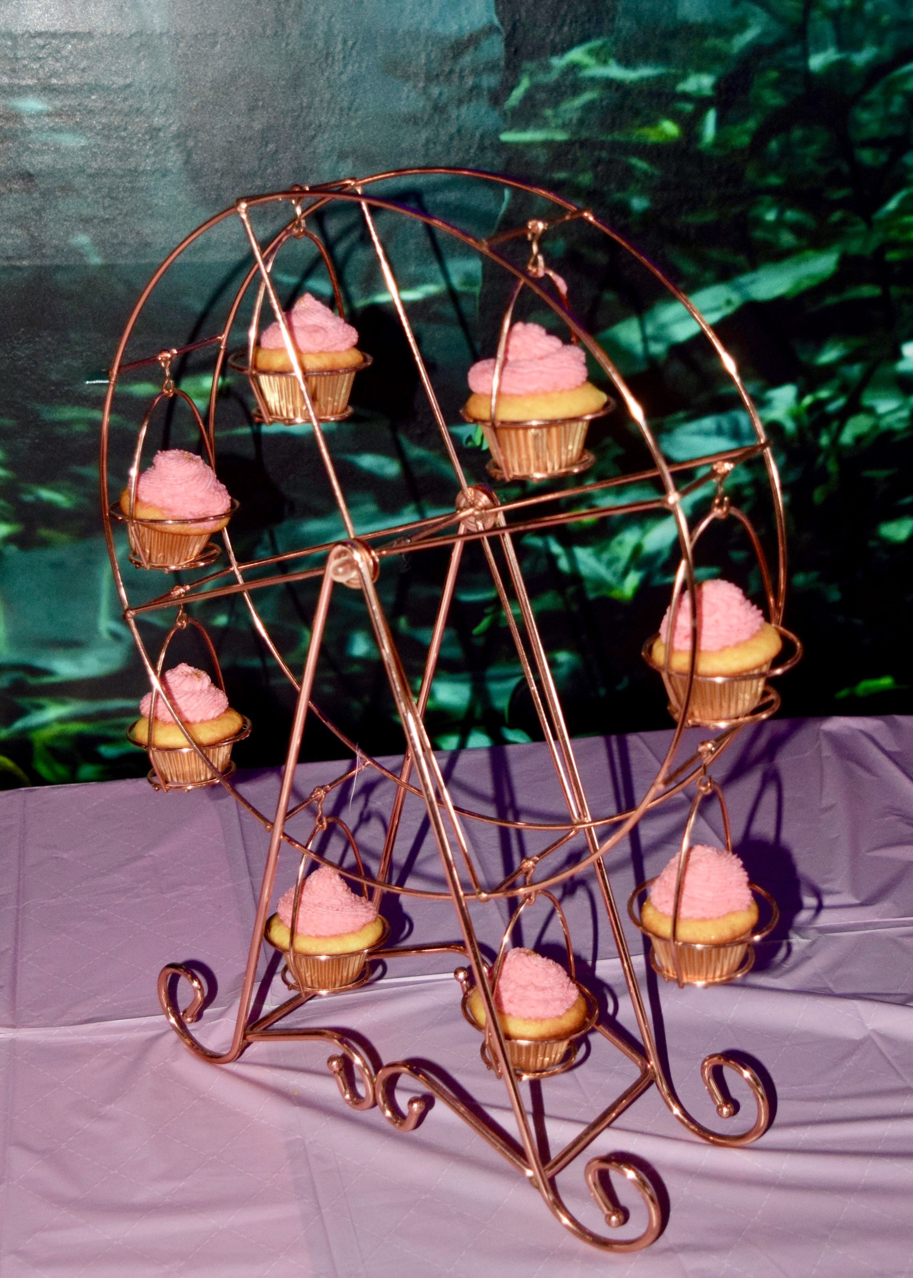Ferris wheel of mini cupcakes. Vanilla cupcakes filled with raspberries and frosted with pink lemonade buttercream frosting.