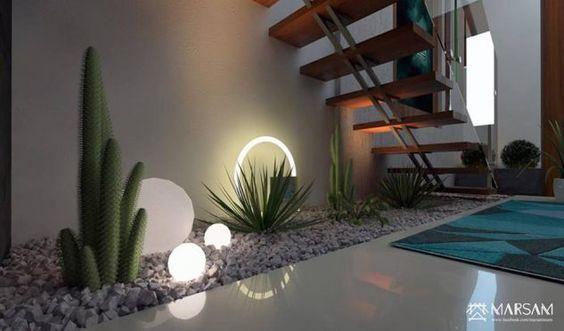 jardines interiores modernos con palmeras arbustos rosas