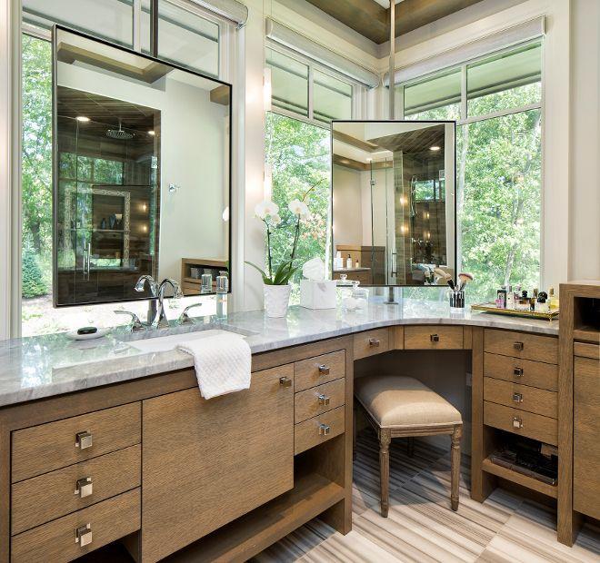 Bathroom With Corner Vanity And Mirror In Front Of Window Hendel